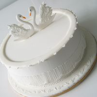 Swans Cake   Cake covered in Royal icing, Royal icing swan toppers