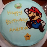 Mario Buttercream frosting with blueberry filling. MMM.