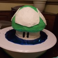 "1-Up Smash  This was a 1-up smash cake I made to go along with a Mario themed birthday party. I used a 4"" for the bottom, 6"" in the middle,..."