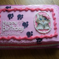 Pretty Kitty Pink buttercream frosted cake. handpainted Kitty..