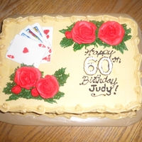 60Th Birthday Cake Gold/yellow buttercream, buttercream roses and fondant handpainted playing cards