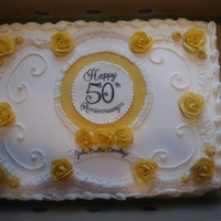 50Th Golden Anniversary 50th golden anniversary cake all buttercream. Fondant painted crest in middle.