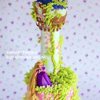 Tangled Tower   Tangled tower cake with a doll to keep and play with x