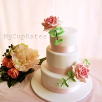 3 Tier Wedding Cake  pastel pink, light green, white theme 3-tier wedding cake decorated with giant sugar roses. chocolate cake with chocolate ganache &...