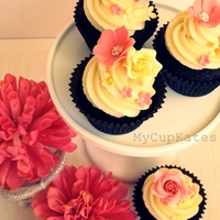 Spring-Like Flower Cupcakes   Pink & Yellow sugar flower decoration..