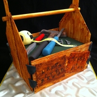"Wooden Tool Box 8"" square choc mud cake carved down a little. Filled with vanilla imbc and covered in ganache and sugarpaste. Pastillage wooden slats..."