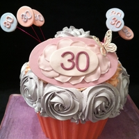 Giant Cupcake giant cupcake. Chocolate shell, coloured italian meringue buttercream roses