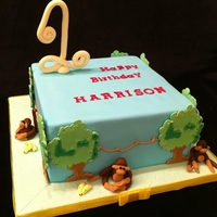 "Monkey Cake 8"" square choc mud cake filled with vanilla imbc and covered with ganache and sugarpaste. Royal icing run out trees, piped vines and..."