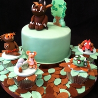 "Gruffalo Gang 6"" choc mud filled with choc imbc and covered in ganache and sugarpaste. Each character is sat on individual cupcakes"