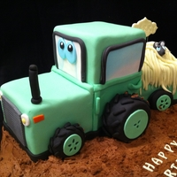 "Tractor Cake 9"" square madeira carved to resemble tractor"