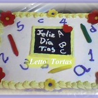 For My Son'steachers Filling was manjar (dulce de leche) and crema pastelera, Icing made of chantilly cream. Crayons, blackboard and flowers made of MMF. They...