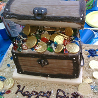 Treasure Chest My daughter's 5th Birthday cake for her pirate themed party. First time working with Fondant...not bad I think.