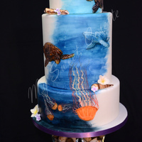 Ocean Themed Cake. Free Hand Painting. Free hand painting with fondant seashells and flowers.