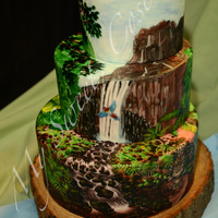 Jungle Cake All hand painted jungle cake. My talented husband wanted to a colored painting, as his last two were painted only in black. Some people...