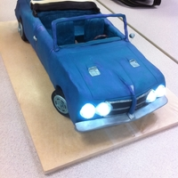 '64 Pontiac Gto Made this cake for a coworker who has this car. Cake has a brownie base, then a milk chocolate chassis and doors, and then chocolate fudge...
