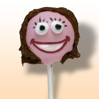 Me In Cake Pop Form! Red velvet cake ball (mixed with cream cheese frosting), dunked in pink candy coating and decorated with gel writers and milk chocolate...