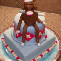 Sock Monkey Baby Shower Cake Made out of marshmallow fondant.