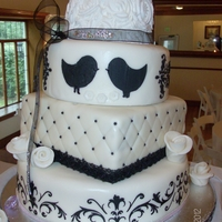 Black And White Wedding Cake This was a first for me. My first wedding cake, first time stenciling and first time doing rosettes. Thank you to all of those that have...