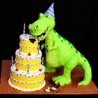 Very Hungry Dino Everything is cake except for the dino's head,tail and legs.His body and the 3 tier b-day cake is all chocolate cake.