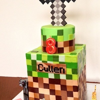 Minecraft Birthday Cake Cake covered in modeling chocolate squares. Sword is also made of modeling chocolate.