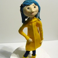 "Coraline Figurine  Figure inspired by the ""Coraline"" movie. She is made of modeling chocolate and then covered with a thin overlay of fondant. This..."