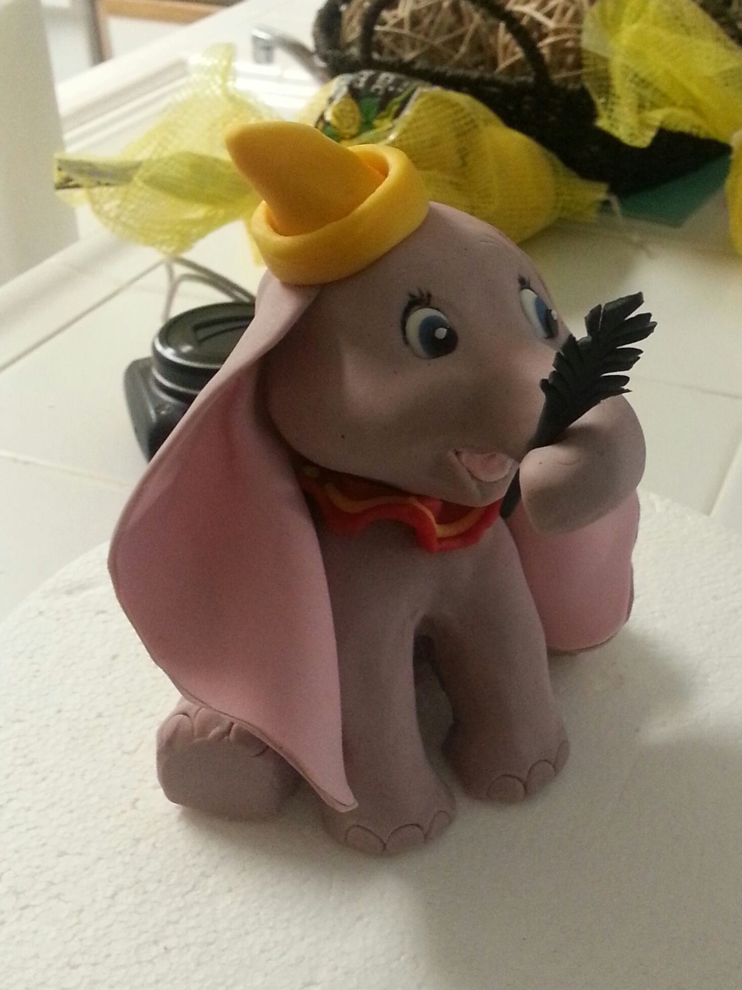 Dumbo Cake Topper Hand sculpted from modeling chocolate and overlaid with fondant 'skin'. Made thus for a friends little girl, as a topper for her...