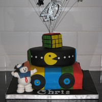 40Th Birthday Cake 2 tier 80's themed 40th birthday cake made for my husband complete with records, pacman, rubiks cube and marshmallow man