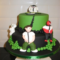 Ben 10 Ben 10 two tier cake with models of alien alteregos and Ben 10. Made for my son's 5th birthday.