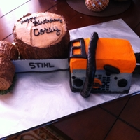 Chainsaw Birthday Chainsaw and Tree made with white cake and blade and bar are made with fondant.
