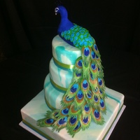 The Pea Is Rice Krispie Treats And Gumpaste The Feathers Are Layered Fondant With Luster Dust The Cake Is Covered In Marbled Fondant The pea**** is Rice Krispie treats and gumpaste. The feathers are layered fondant with luster dust. The cake is covered in marbled fondant...