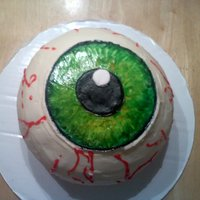 Eyeball Cake Covered with Buttercream, used 2 kitchen bowls, mm fondant iris and 10 yr. old painted it.