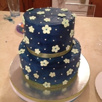 Navy And Green Wedding Buttercream wedding cake with gumpaste flowers and sugar pearls with 200 matching cupcakes - not the best picture of the cake. The bride...