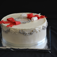 Silver And Pearl Cake. .If you would like to know how to decorate sides on this cake , you can watch my tutorial on you tube. You can find it by taping sdcakes....
