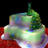 Peacock Wedding Cake Gumpaste peacock topper, cake filled and iced with French Buttercream. Airbrushed for an exotic effect.