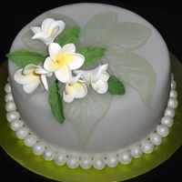 Gumpaste Frangipani On Fondant Covered Cake, Painted Fondant. Gumpaste Frangipani on Fondant Covered Cake, buttercream painting.