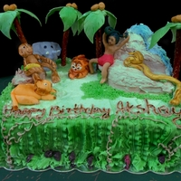 Jungle Book Jungle Book theme cake for a boy who turned 7. Edible hand molded fondant animals and little boy, coconut trees, rock- you can eat them all...