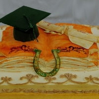 Graduation Book Cake Graduation cake- gumpaste cap, horse shoe and diploma scroll. Painted sugarpaste book cake cover with orange - the Westwood Highschool...