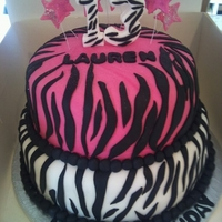 Pink/white Print 2 tier girly cake for 13th birthday