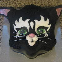 Kitty Kat I did this kitty Kat for a 5th birthday. Chocolate mud cake layered then carved then covered with chocolate ganache, fondant and some...