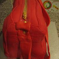 40Th Hand Bag Cake I made this cake for my sister in law who turned 40 on Good Friday. Her favourite colour is red so quite appropriate. 5 layer cake (carved...