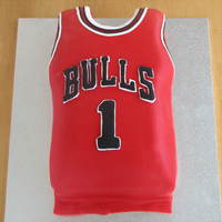 Bulls Singlet Carved cake 1/2 banana 1/2 chocolate with ganache and decorated with fondant.