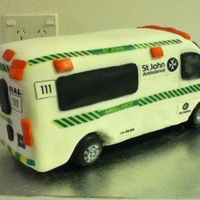Ambulance Cake chocolate mud cake covered with fondant and edible design. Opps! forgot to put the side mirrors on. Unfortunately not very clear photos