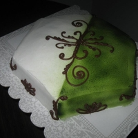 Green & White Hexagon cake with buttercream icing. Airbrushed with free hand scroll work