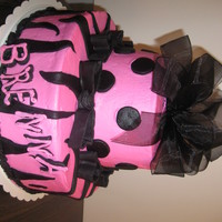 Zebra & Bows Hot Pink Buttercream Cake with Fondant Bows. Florist Bow was added to the top.