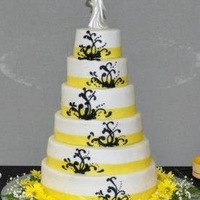 Daisy Classic Wedding cake with Buttercream Icing and Yellow ribbon. Scroll work done with Buttercream Icing. Freehanded.