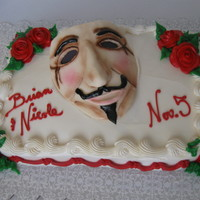 Vendetta Buttercream Cake with Gumpaste Mask matching a movie theme.