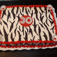Zebra Cake Zebra Cake with red and silver fondant accents