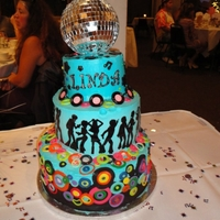 70's Disco 2 tier cake covered in buttercream with fondant accents. Topped with a mirrored disco ball! 50th Birthday, 70's DISCO PARTY