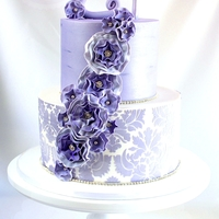 Lavender Elegance  This two tier cake was made for a 21st for a lovely elegant young lady. I was so unsure abut the design until it was almost done then the...