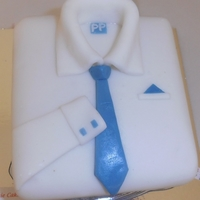 Men's Shirt Cake Men's shirt cake covered with fondant icing.
